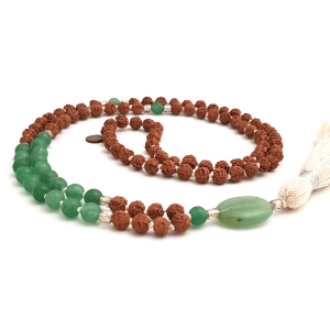 Handmade Green Aventurine and Rudraksha Prosperity mala curled on table