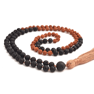 Handmdae lava and Rudraksha mala curled on table