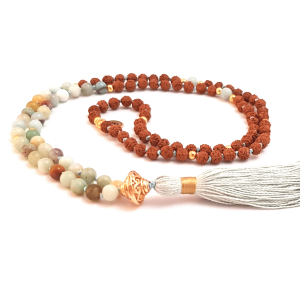 Handmade Amazonite and Rudraksha mala curled on table