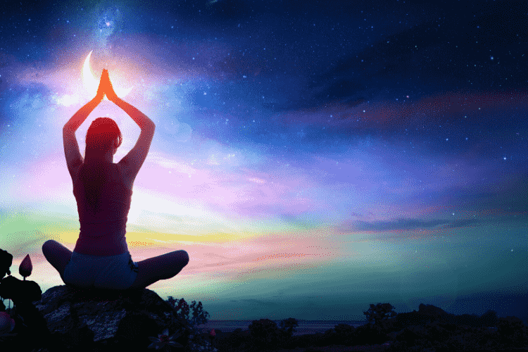Meditating with vivid night sky in front