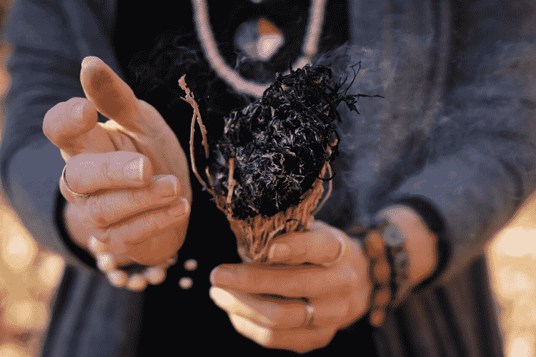 Women smudging with white sage
