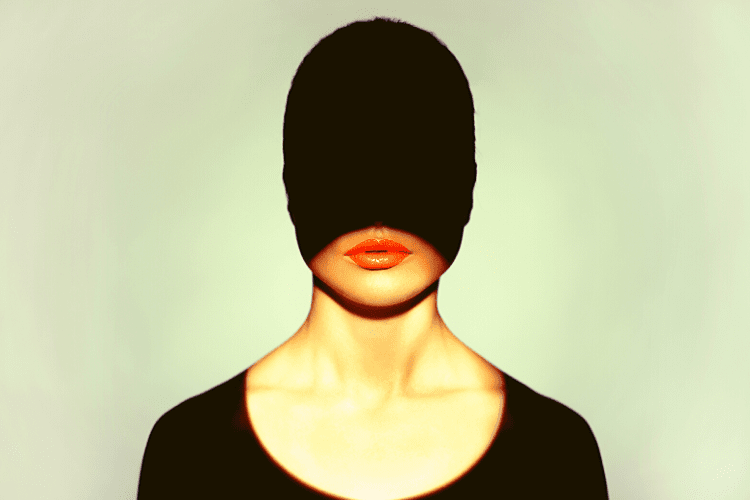 Women with half her face in shadow