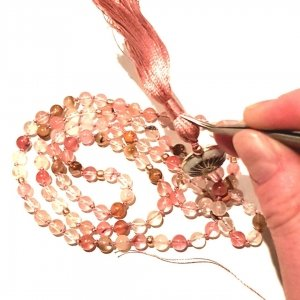 Carol Fung from Seeds of Wonder making crystal mala