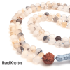 Close up of Agate hand knotted mala-labelled