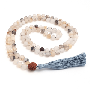 Stabilising Agate handmade mala curled on table