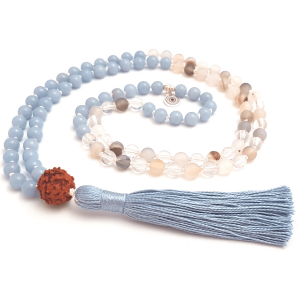 Handmade Throat Chakra mala with Angelite Quartz Agate and Rudraksha beeds curled on table