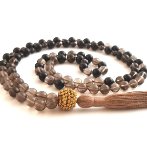 Handmade Smokey Quartz Root Chakra mala curled on table