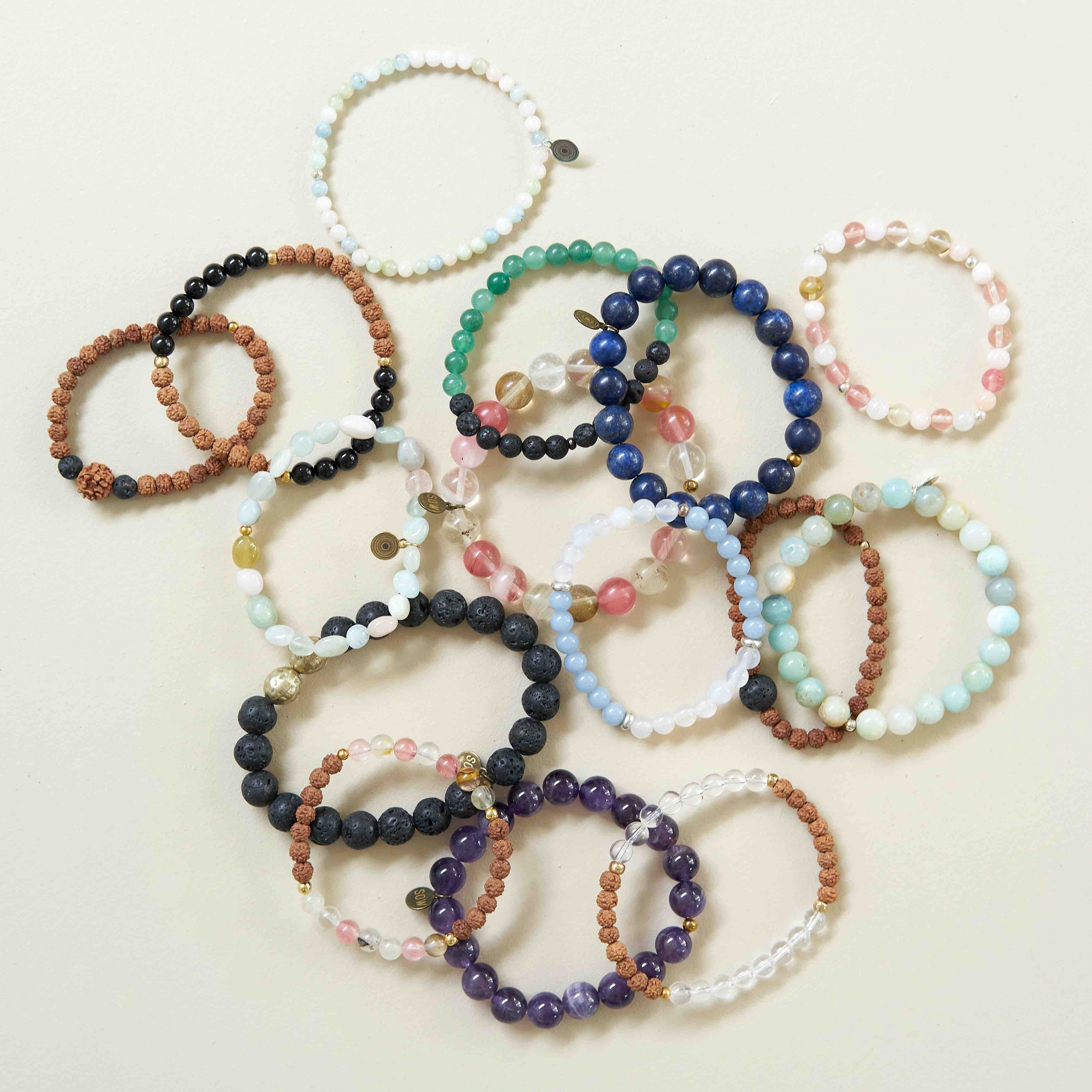 Handmade bracelets in pile on a table