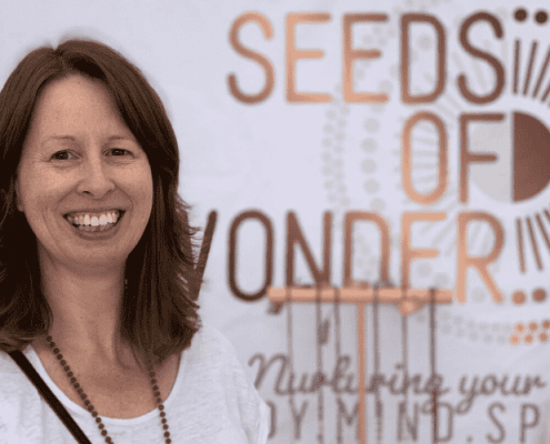 Seeds of Wonder founder in front of marque