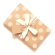 Polka dot kraft paper wrap with white ribbon and twine tie